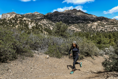 athletic ultra marathon woman running in