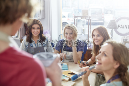 female art students listening to instructor