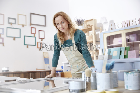 portrait confident female artist painting mirror