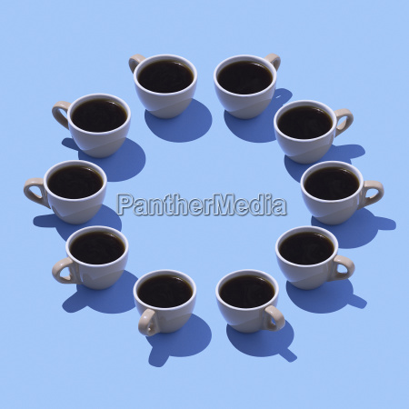 coffee cups building circle on light