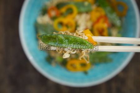 chopsticks with mie noodles chili pod