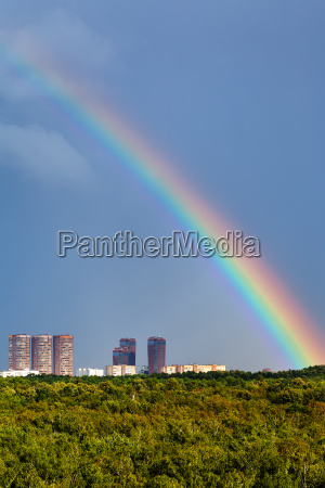 rainbow in dark blue sky over
