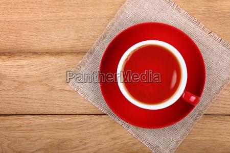 full cup of black tea in