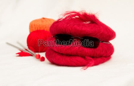 wool knot with knitting needles
