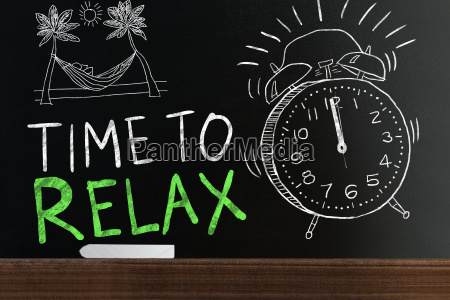 time to relax words on blackboard