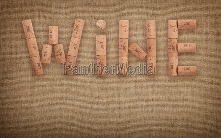 word wine shaped by corks over