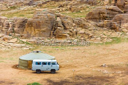 tourist van outside yurt rocky mongolian
