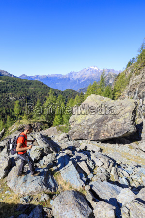 hiker on the rocky path proceeds