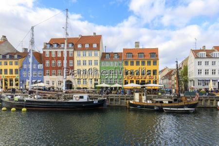 colourful facades along canal and entertainment