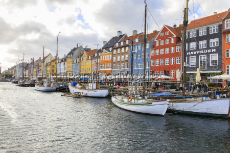 colourful facades and typical boats along