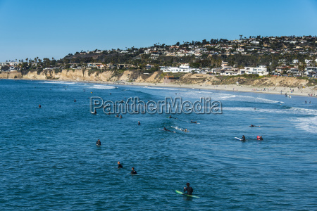surfers waiting in the waters of