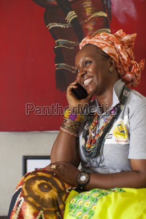 a woman smiling whilst talking on