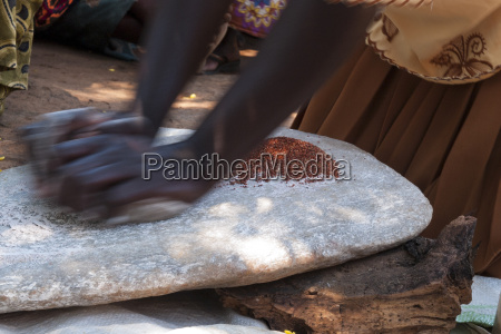 a woman using two stones to