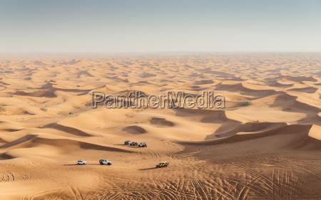 offroad vehicles on sand dunes near