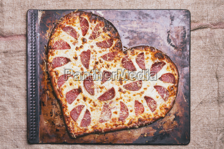 heart shaped pizza on pan