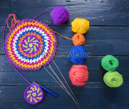 knitting needles and multicolor yarn on