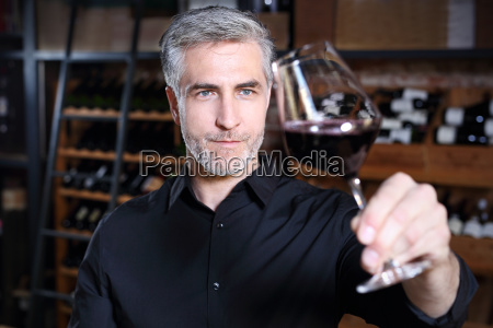 sommelier tasting red wine wine cellar