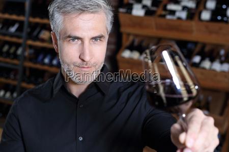sommelier tasting red wine wine cellar