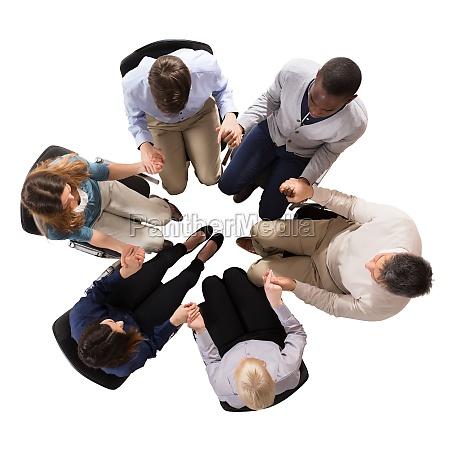 business team holding hands together