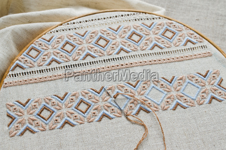 embroidered fragment by brown and beige