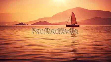 sailboat in beautiful sunset light
