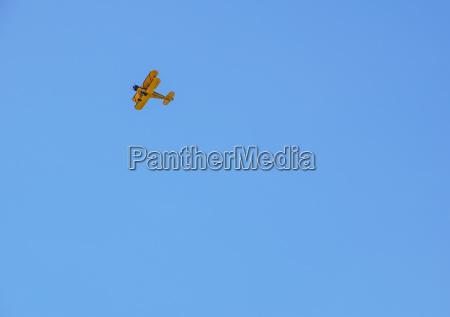 vintage airplane in flight at
