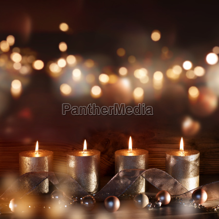 christmas decoration with candles and bokeh