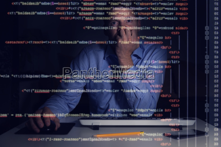 programmer working with programming code on