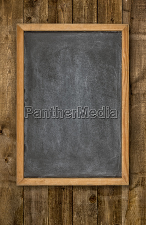 empty shield in front of wooden