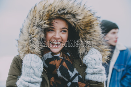 woman, laughing, on, a, winter, beach - 23019289