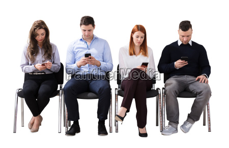 business people sitting on chair using
