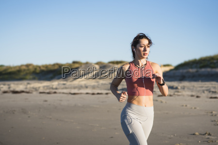 young woman running as part of