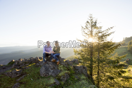 couple sitting together in natural scenery