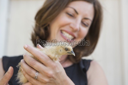 a woman holding a small fluffy