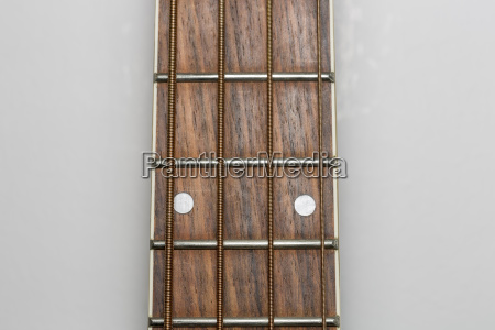 acoustic bass guitar fretboard close up