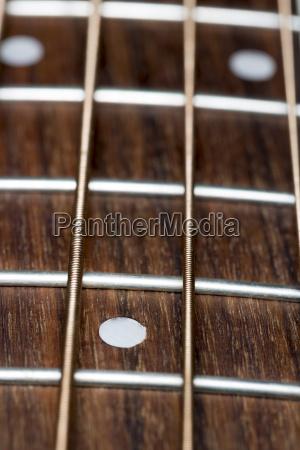 acoustic bass guitar fretboard close up