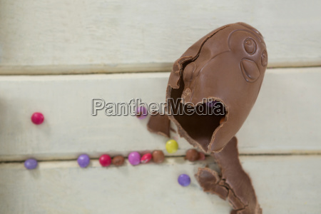 broken chocolate easter egg on wooden