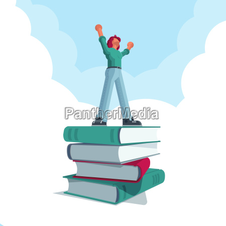 successful man standing on big book