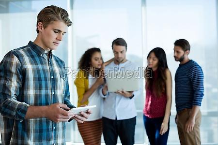 man using digital tablet in office