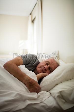 senior man sleeping in the bedroom