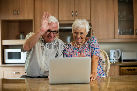 senior couple using laptop in the