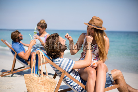 romantic couples sitting on deck chairs