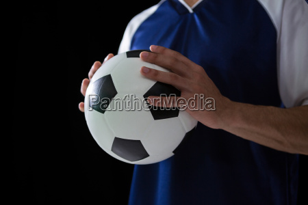 mid section of football player holding