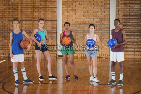 group of high school team holding