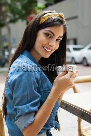 portrait of beautiful smiling woman drinking
