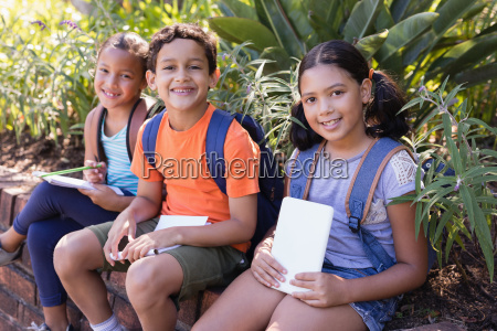 friends holding books while sitting on