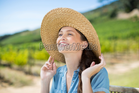 happy woman wearing sun hat while