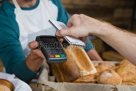 customer paying bill through smartphone using