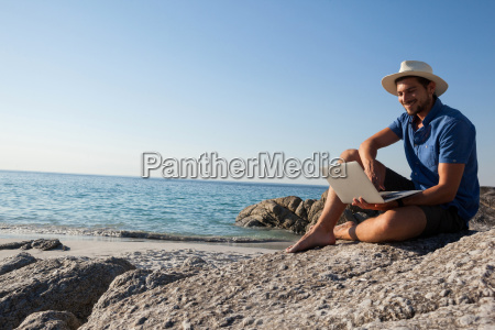 man sitting on the rocks and