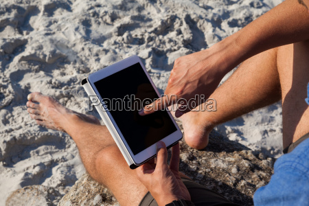 man using digital tablet on the
